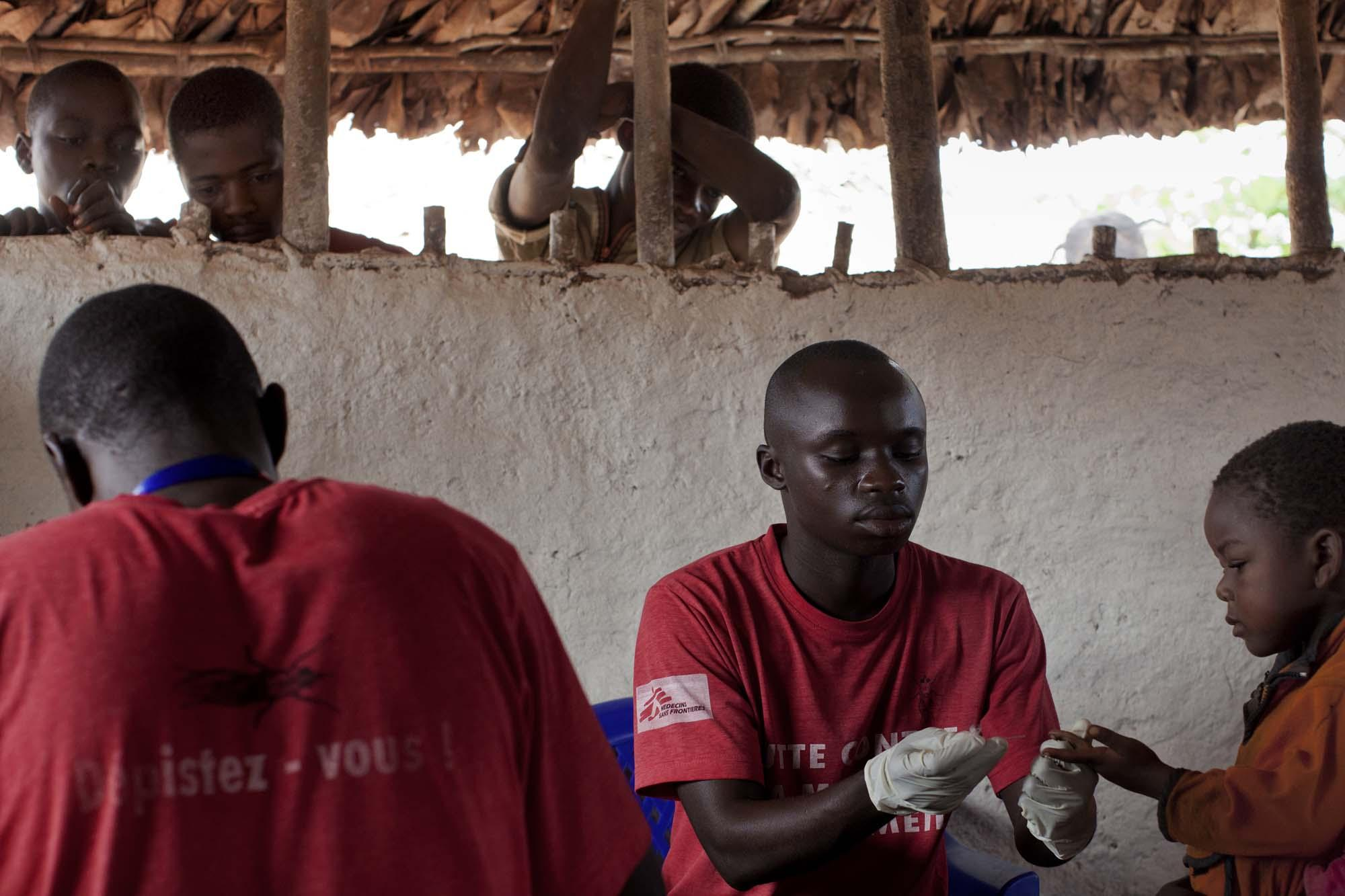 Médecins Sans Frontières (MSF) mobile clinic staff runs blood tests to diagnose sleeping sickness in  the village of Emmaus, northeast DRC.