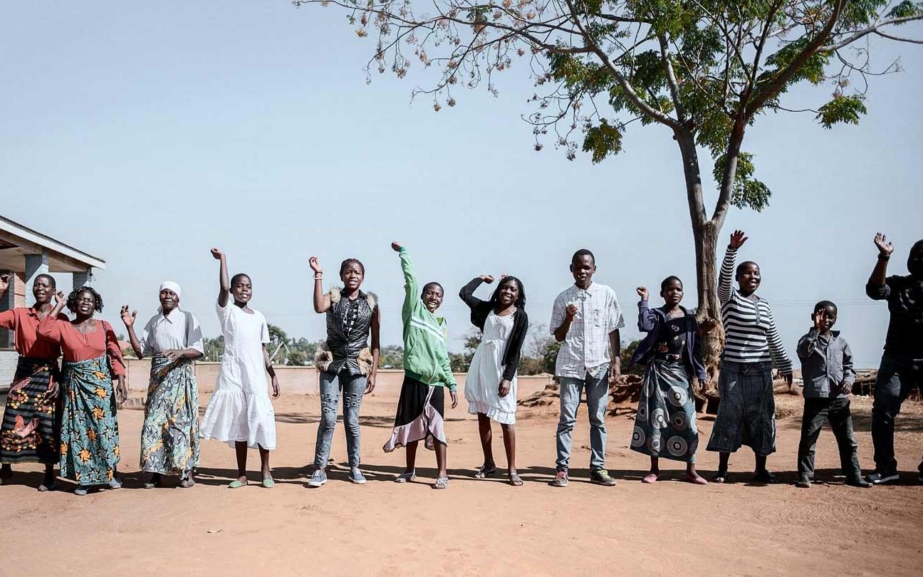 Adolescent HIV project, in Malawi. Dance to start the 'six-months-meeting day' to welcome new members and monitor all the girls and boys who already joined the programme.